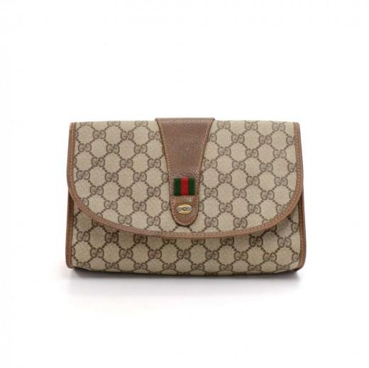 c891af74a6d7f6 Vintage Gucci Accessory Collection GG Supreme Coated Canvas Clutch Bag