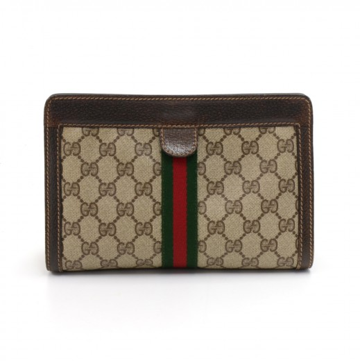 6ec860bcccdc Vintage Gucci Accessory Collection GG Supreme Coated Canvas Clutch Bag