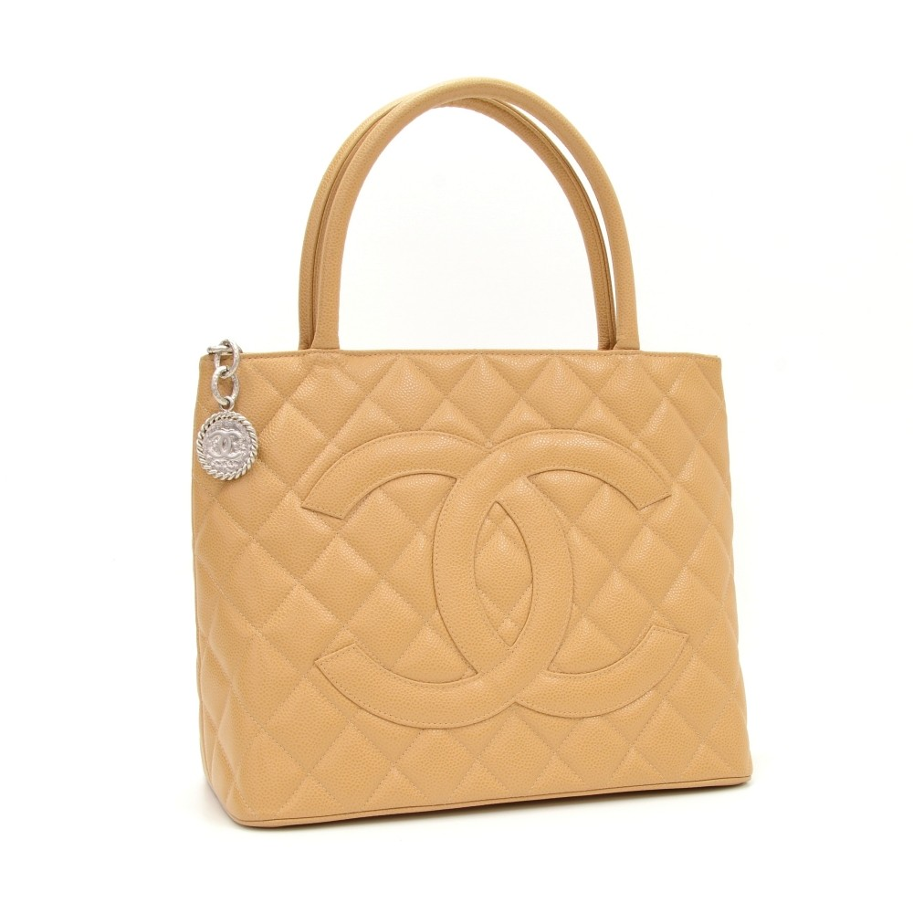 7e634111f4df Chanel Chanel Revival Medallion Beige Quilted Caviar Leather Tote ...