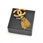 Vintage Chanel Etruscan Style Textured CC logo Tassel Brooch
